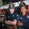 "UAF student firefighters/EMTs John McGee and Lillian Hampton pose in front of one of the firetrucks housed in the Whitaker Building on the Fairbanks campus.  <div class=""ss-paypal-button"">Filename: AAR-11-3223-132.jpg</div><div class=""ss-paypal-button-end"" style=""""></div>"