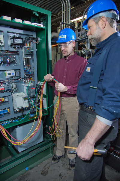 """Tom Johnson, left, and Dave Light, research professionals with the Alaska Center for Energy and Power, inspects newly installed equipment in the UAF power plant designed to help capture heat generated by diesel engines.  <div class=""""ss-paypal-button"""">Filename: AAR-11-3245-131.jpg</div><div class=""""ss-paypal-button-end"""" style=""""""""></div>"""