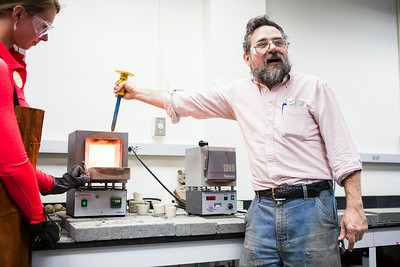 "Rainer Newberry of the Department of Geology and Geophysics prepares to demonstrate a ""lava"" flow during the 2014 Science Potpourri at the Reichardt Building.  Filename: AAR-14-4141-130.jpg"