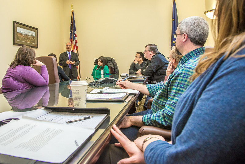 """Professor Mike Davis and his students in RD 492 - Understanding the Legislative Process, meet with Rep. Les Gara, (D, Anchorage) in a legislative conference room during their week-long seminar in Juneau.  <div class=""""ss-paypal-button"""">Filename: AAR-13-3714-281.jpg</div><div class=""""ss-paypal-button-end"""" style=""""""""></div>"""