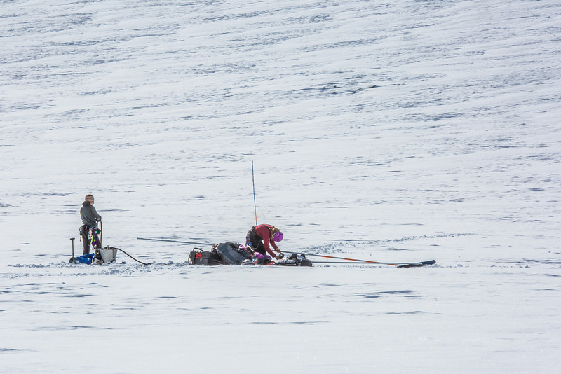 """Research Assistant Professor Anna Liljedahl, right, works with UAF graduate student Joanna Young to install stakes for measuring glacier melt on the Jarvis Glacier, about 35 miles south of Delta Junction.  <div class=""""ss-paypal-button"""">Filename: AAR-13-3795-577.jpg</div><div class=""""ss-paypal-button-end"""" style=""""""""></div>"""