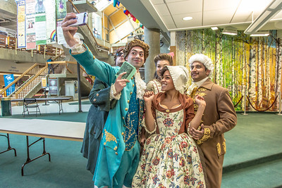 """Cast members of Theatre UAF's production of """"Tartuffe"""" pose for a selfie before performing a live teaser in Wood Center a couple of days before opening night.  Filename: AAR-14-4121-43.jpg"""