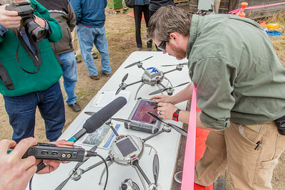 Pilot Mike Cook demonstrates use of the control tablet for the Aeryon Scout quadcopter  after its historic flight May 5 at UAF's Large Animal Research Station.  Filename: AAR-14-4172-164.jpg