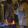 "Art major Joel Isaak, left, returns a pot of molten bronze into the furnace as part of the process of creating a life-sized sculpture for his senior thesis in the UAF Fine Arts complex.  <div class=""ss-paypal-button"">Filename: AAR-12-3347-111.jpg</div><div class=""ss-paypal-button-end"" style=""""></div>"