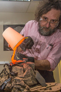 Geology professor Rainer Newberry pours hot lava over volcanic basalt in a lab in the Reichardt Building on the Fairbanks campus.  Filename: AAR-13-3730-49.jpg