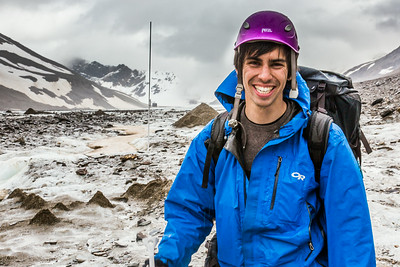 Tristan Weiss, a research technician with the Institute of Northern Engineering, poses during a research field trip to the Jarvis Glacier in the eastern Alaska Range.  Filename: AAR-14-4256-469.jpg