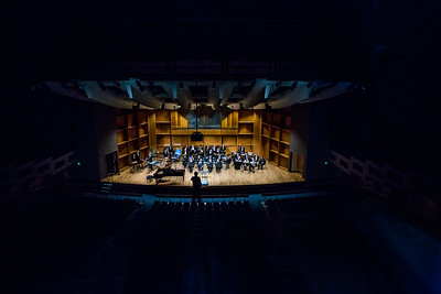 The UAF Wind Symphony poses for a picture during their pre-concert warmup on Nov. 18, 2016.  Filename: AAR-16-5070-1.jpg