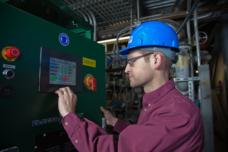 "Tom Johnson, a research professional with the Alaska Center for Energy and Power, inspects newly installed equipment in the UAF power plant designed to help capture heat generated by diesel engines.  <div class=""ss-paypal-button"">Filename: AAR-11-3245-113.jpg</div><div class=""ss-paypal-button-end"" style=""""></div>"