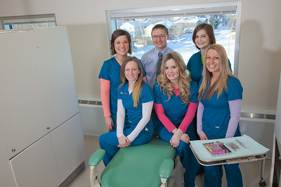 Students in the CTC dental hygienist program pose for a group photo with program director Vaughan Hoefler in their training facility in downtown Fairbanks.  Filename: AAR-12-3308-189.jpg