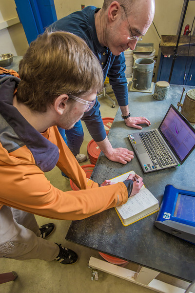 """Professor David Barnes analyzes data collected in the field with undergraduate engineering major Logan Little as part of their research on dust abatement.  <div class=""""ss-paypal-button"""">Filename: AAR-13-3812-63.jpg</div><div class=""""ss-paypal-button-end"""" style=""""""""></div>"""