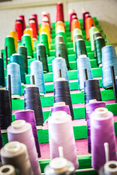 """Spools of thread are among supplies in the costume shop at Theatre UAF.  <div class=""""ss-paypal-button"""">Filename: AAR-14-4104-24.jpg</div><div class=""""ss-paypal-button-end"""" style=""""""""></div>"""