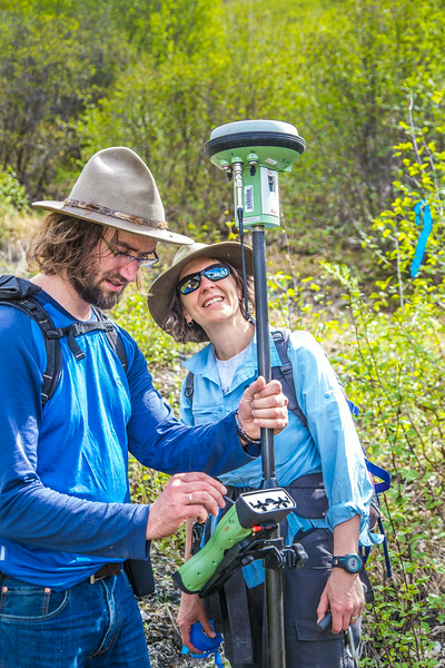 """Associate professor Margaret Darrow, right, and state geologist Ronald Daanen take a reading from GPS tracking device as they make their way down one of several frozen debris lobes which have appeared along the Dietrich River valley in the southern Brooks Range  which could threaten the highway and the nearby trans-Alaska pipeline.  <div class=""""ss-paypal-button"""">Filename: AAR-14-4214-346.jpg</div><div class=""""ss-paypal-button-end""""></div>"""