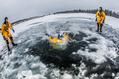 Student firefighters practice cold-water rescue techniques at a pond near the Fairbanks campus.  Filename: AAR-13-3797-52.jpg