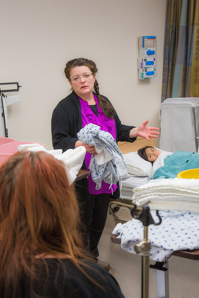 """Instructor Cindy Schmitt, right, describes a procedure to students during an exercise in the nurse aide training program at UAF's Community and Technical College.  <div class=""""ss-paypal-button"""">Filename: AAR-12-3548-146.jpg</div><div class=""""ss-paypal-button-end"""" style=""""""""></div>"""