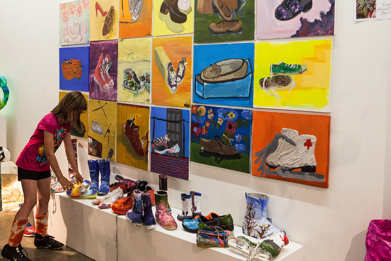"""Students, parents, faculty, and community members view the artwork from the two-week Visual Arts Academy is showcased at the University Art Gallery.  <div class=""""ss-paypal-button"""">Filename: AAR-13-3865-5.jpg</div><div class=""""ss-paypal-button-end"""" style=""""""""></div>"""
