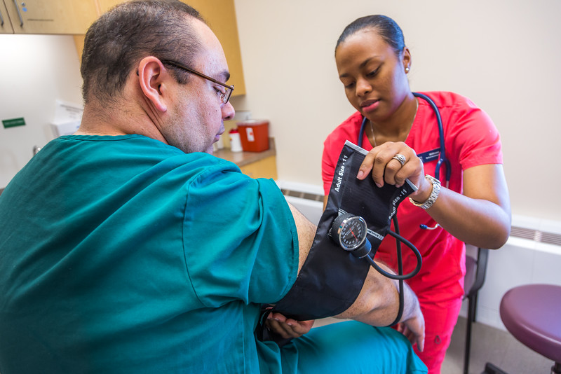 "CTC medical assisting students Millicent Flannel, right, and Greg Parker alternate taking each other's vital signs during a training exercise at the program's facility on Barnette Street in downtown Fairbanks.  <div class=""ss-paypal-button"">Filename: AAR-16-4873-308.jpg</div><div class=""ss-paypal-button-end""></div>"