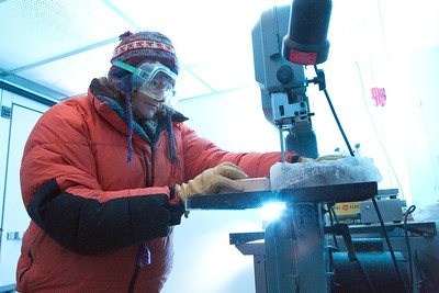 Assistant professor of geophysics Erin Pettit cuts slices of glacier samples in the Elvey Building's ice lab.  Filename: AAR-12-3330-005.jpg