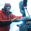 "Assistant professor of geophysics Erin Pettit cuts slices of glacier samples in the Elvey Building's ice lab.  <div class=""ss-paypal-button"">Filename: AAR-12-3330-005.jpg</div><div class=""ss-paypal-button-end"" style=""""></div>"