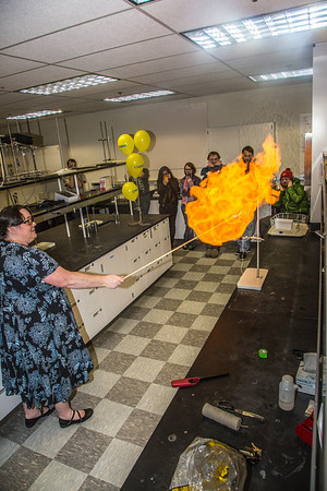 UAF chemistry professor Cathy Cahill seems to enjoy blowing up balloons filled with hydrogen during a demonstration for her students in a Reichardt Building lab.  Filename: AAR-13-4021-1.jpg