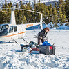 "Geophysical Institute graduate student Joanna  Young packs gear before taking a helicopter to access sites on the Jarvis Glacier, about 35 miles south of Delta Junction. Young is part of a UAF team investigating future flow in rivers coming directly from glaciers, as bridges and road networks can be affected by varying water levels.  <div class=""ss-paypal-button"">Filename: AAR-13-3795-19.jpg</div><div class=""ss-paypal-button-end"" style=""""></div>"