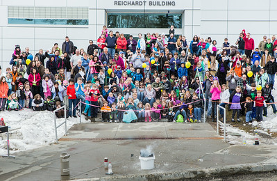 Youngsters and their parents react to a explosion demonstration during the Science Potpourri event at the Reichardt Building.  Filename: AAR-14-4141-194.jpg