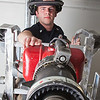 "UAF student firefighter/EMT Ethan Stevenson checks some of the equipment aboard one of the firetrucks housed in the Whitaker Building on the Fairbanks campus.  <div class=""ss-paypal-button"">Filename: AAR-11-3223-126.jpg</div><div class=""ss-paypal-button-end"" style=""""></div>"