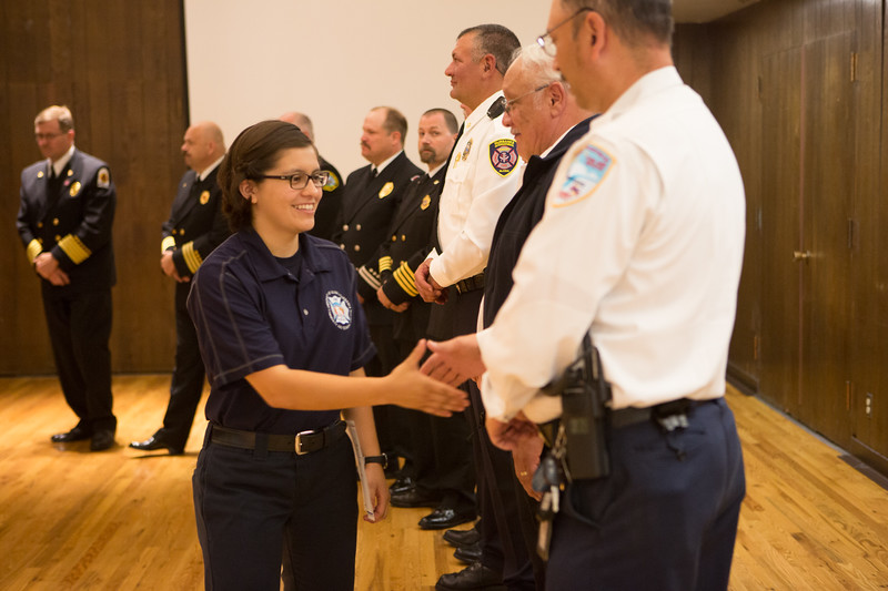 """Fabienne Munoz is congratulated by local fire chiefs after graduating from the 2016 Summer Fire Academy at the Wood Center ballroom.  <div class=""""ss-paypal-button"""">Filename: AAR-16-4960-181.jpg</div><div class=""""ss-paypal-button-end""""></div>"""