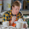 """Art major Ian Wilkinson trims one of the approximately 1,000 ceramic bowls needed for his senior thesis project in the fine arts complex on the Fairbanks campus.  <div class=""""ss-paypal-button"""">Filename: AAR-12-3547-090.jpg</div><div class=""""ss-paypal-button-end"""" style=""""""""></div>"""