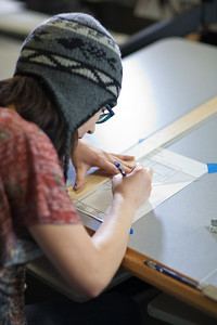 Michelle Kubo works through her assignment in her drafting class at UAF's Community and Technical College.  Filename: AAR-11-3221-18.jpg