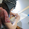 """Michelle Kubo works through her assignment in her drafting class at UAF's Community and Technical College.  <div class=""""ss-paypal-button"""">Filename: AAR-11-3221-18.jpg</div><div class=""""ss-paypal-button-end"""" style=""""""""></div>"""