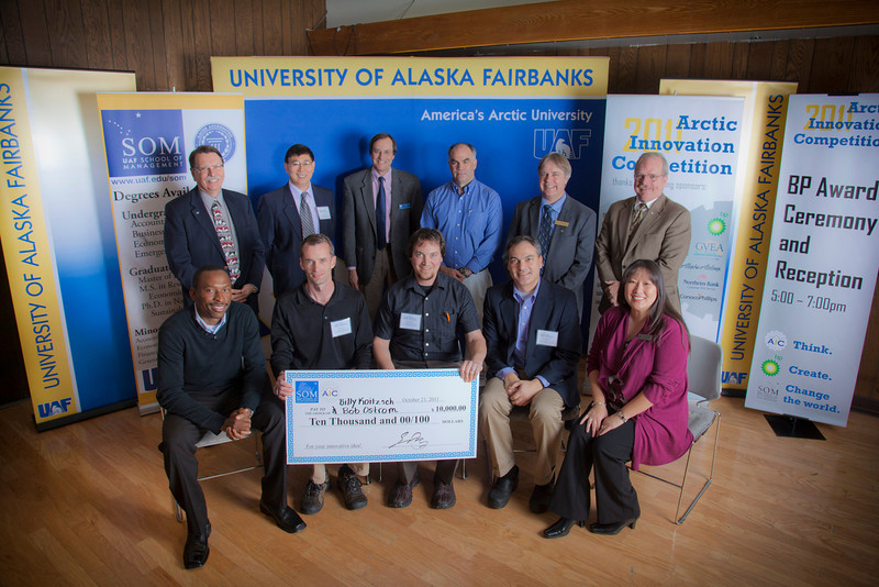 "The first place winners of the Arctic Innovation Competition (right) Billy Koitzsch & Bob Ostrom (left) sit with UAF and BP Sponsores of the AIC.  <div class=""ss-paypal-button"">Filename: AAR-11-3201-494.jpg</div><div class=""ss-paypal-button-end"" style=""""></div>"