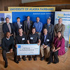 "The first place winners of the Arctic Innovation Competition (right) Billy Koitzsch &amp; Bob Ostrom (left) sit with UAF and BP Sponsores of the AIC.  <div class=""ss-paypal-button"">Filename: AAR-11-3201-494.jpg</div><div class=""ss-paypal-button-end"" style=""""></div>"