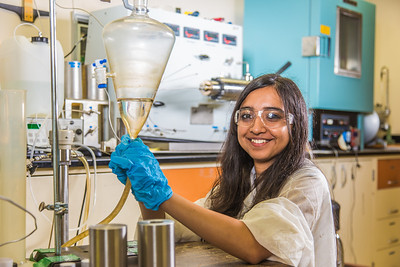 Graduate student Shruti Oza sets up apparatus for a procedure in UAF's Petroleum Development Lab in the Duckering Building.  Filename: AAR-13-3918-232.jpg