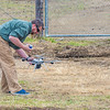 """Pilot Mike Cook retreives the payload after the initial flight of the Aeryon Scout quadcopter at UAF's Large Animal Research Station.  <div class=""""ss-paypal-button"""">Filename: AAR-14-4172-130.jpg</div><div class=""""ss-paypal-button-end""""></div>"""