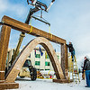 "Engineering students clear the bottom of one of the vertical supports as they raise the 2013 ice arch in Cornerstone Plaza on the Fairbanks campus. Students this year built the structure out of a mixture of ice and sawdust, which is many times stronger than concrete.  <div class=""ss-paypal-button"">Filename: AAR-13-3736-156.jpg</div><div class=""ss-paypal-button-end"" style=""""></div>"