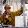 """Ph.D. candidate Amanda Lindoo works in the Reichardt Building petrology lab.  <div class=""""ss-paypal-button"""">Filename: AAR-16-4828-121.jpg</div><div class=""""ss-paypal-button-end""""></div>"""