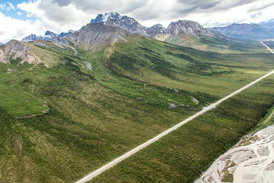 This photo shows three of several frozen debris lobes which are moving at various speeds down the hillsides along the Dietrich River valley in the southern Brooks Range, posing a serious threat to the Dalton Highway and Trans-Alaska Pipeline.  Filename: AAR-14-4219-085.jpg