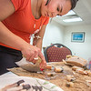 "Kelsey Wallace, a senior in UAF's rural development program from Bethel, chops muktuk before a potluck dinner hosted by students during a weeklong seminar on understanding the legislative process. Several state legislators and other officials attended the event at the Goldbelt Hotel in Juneau.  <div class=""ss-paypal-button"">Filename: AAR-14-4055-376.jpg</div><div class=""ss-paypal-button-end"" style=""""></div>"