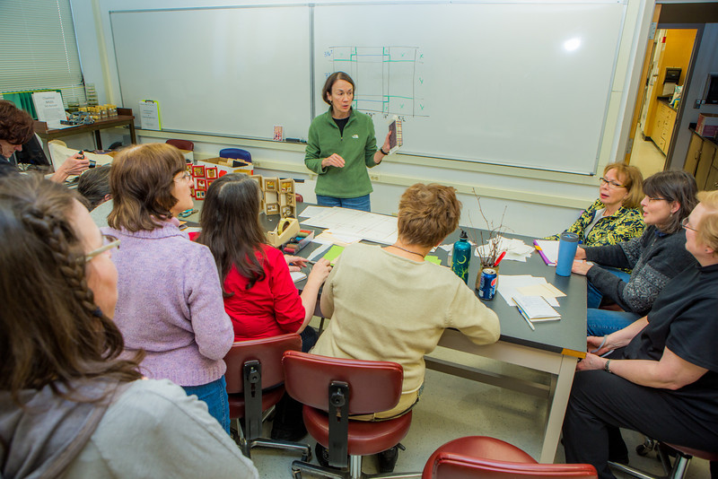 """Instructor Margo Klass shows off finished projects in a custom book binding workshop offered by UAF Summer Sessions during Wintermester 2013.  <div class=""""ss-paypal-button"""">Filename: AAR-13-3706-45.jpg</div><div class=""""ss-paypal-button-end"""" style=""""""""></div>"""