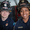 "UAF student firefighters/EMTs John McGee and Lillian Hampton pose in front of one of the firetrucks housed in the Whitaker Building on the Fairbanks campus.  <div class=""ss-paypal-button"">Filename: AAR-11-3223-134.jpg</div><div class=""ss-paypal-button-end"" style=""""></div>"