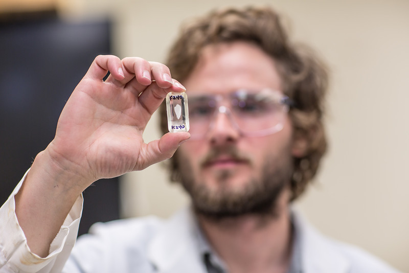 """Ph.D. candidate Sean Brennan works in a lab in the Water and Environmental Research Center in the Duckering Building.  <div class=""""ss-paypal-button"""">Filename: AAR-12-3579-44.jpg</div><div class=""""ss-paypal-button-end"""" style=""""""""></div>"""