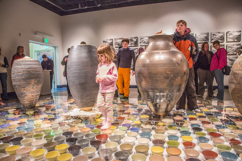 """Patrons of all ages walked around on the ceramic artwork produced by Ian Wilkinson for his BFA thesis during the opening of his show in the gallery in the UAF Fine Arts Complex.  <div class=""""ss-paypal-button"""">Filename: AAR-13-3780-365.jpg</div><div class=""""ss-paypal-button-end"""" style=""""""""></div>"""