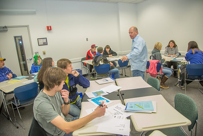 Faculty member Dave Veazey leads a mock geography class during an Inside Out event in a Gruening Building classroom.  Filename: AAR-12-3609-44.jpg