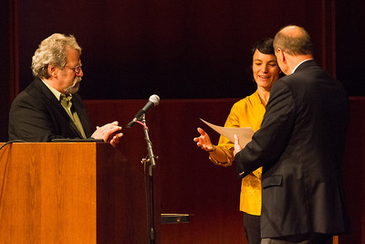 Members of the Alaska legislature Rep. Dave Guttenberg and Sen. Joe Thomas present UAF Film department head Maya Salganek with a copy of the proclamation. The state voted to continue to offer economic incentives for film and television producers to shoot in Alaska. Salganek was vital in organizing a grassroots campaign that demonstrated strong support for the program.  Filename: AAR-12-3558-42.jpg