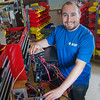 """Graduate student Richard Stevens works on components of a desktop computer in the workshop of the Alaska Center for Energy and Power on the Fairbanks campus.  <div class=""""ss-paypal-button"""">Filename: AAR-11-3245-62.jpg</div><div class=""""ss-paypal-button-end"""" style=""""""""></div>"""