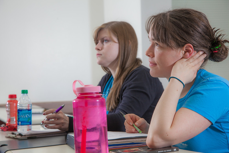 """Senior foreign languages major Lindsey Miller listens in her Hispanic Theater class during a recent meeting in the Gruening Building.  <div class=""""ss-paypal-button"""">Filename: AAR-12-3350-54.jpg</div><div class=""""ss-paypal-button-end"""" style=""""""""></div>"""