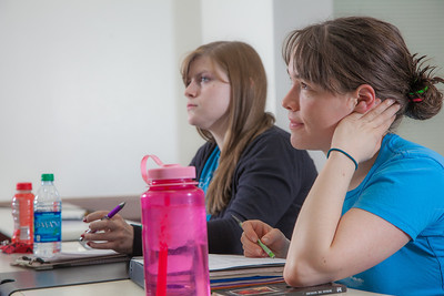 Senior foreign languages major Lindsey Miller listens in her Hispanic Theater class during a recent meeting in the Gruening Building.  Filename: AAR-12-3350-54.jpg