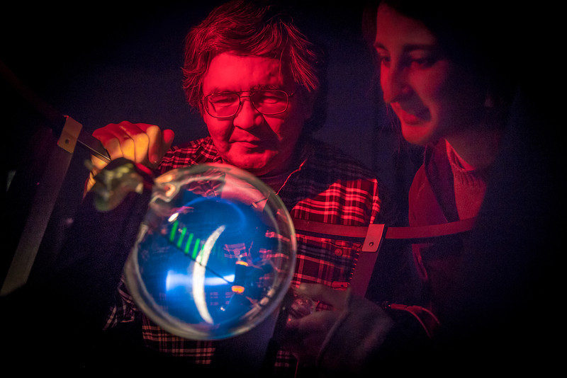 """Physics majors Stanley Edwin, left, and Haley Nelson experiment with a device that creates an artificial aurora borealis in a Reichardt Building lab.  <div class=""""ss-paypal-button"""">Filename: AAR-13-4009-65.jpg</div><div class=""""ss-paypal-button-end"""" style=""""""""></div>"""