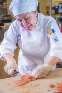 Jenevie Star Burgess prepares smokes salmon to serve at lunch at CTC's culinary arts kitchen in the Hutchison Center.  Filename: AAR-13-3811-16.jpg