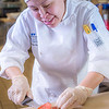 "Jenevie Star Burgess prepares smokes salmon to serve at lunch at CTC's culinary arts kitchen in the Hutchison Center.  <div class=""ss-paypal-button"">Filename: AAR-13-3811-16.jpg</div><div class=""ss-paypal-button-end"" style=""""></div>"
